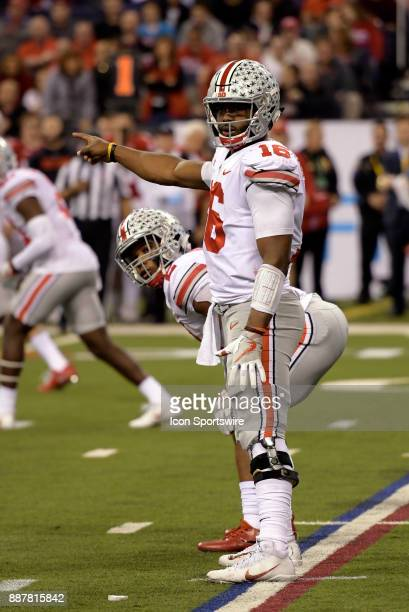 Ohio State Buckeyes quarterback JT Barrett points to the defense during the Big Ten Championship Game between the Ohio State Buckeyes and the...