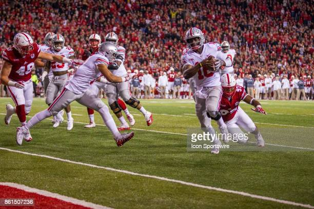 Ohio State Buckeyes quarterback JT Barrett runs in for a touchdown against Nebraska Cornhuskers defensive tackle Deontre Thomas on October 14 2017 at...