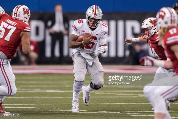 Ohio State Buckeyes quarterback JT Barrett runs up the middle during the Big 10 Championship game between the Wisconsin Badgers and Ohio State...