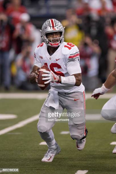Ohio State Buckeyes quarterback JT Barrett scrambles to the outside during the Big 10 Championship game between the Wisconsin Badgers and Ohio State...