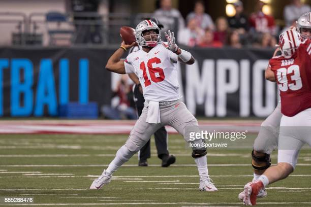 Ohio State Buckeyes quarterback JT Barrett throws a deep pass during the Big 10 Championship game between the Wisconsin Badgers and Ohio State...