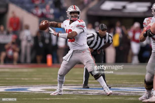 Ohio State Buckeyes quarterback JT Barrett throws downfield during the Big 10 Championship game between the Wisconsin Badgers and Ohio State Buckeyes...