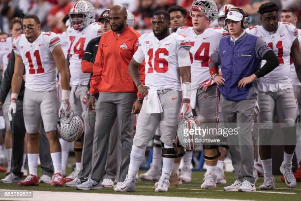 Ohio State Buckeyes quarterback JT Barrett watches a field goal attempt during the Big 10 Championship game between the Wisconsin Badgers and Ohio...