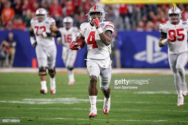 Ohio State Buckeyes running back Curtis Samuel breaks free for a long run during the Playstation Fiesta Bowl college football game between the Ohio...