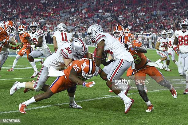 Ohio State Buckeyes wide receiver KJ Hill is tackled by Clemson Tigers cornerback Cordrea Tankersley and Clemson Tigers safety Jadar Johnson in...