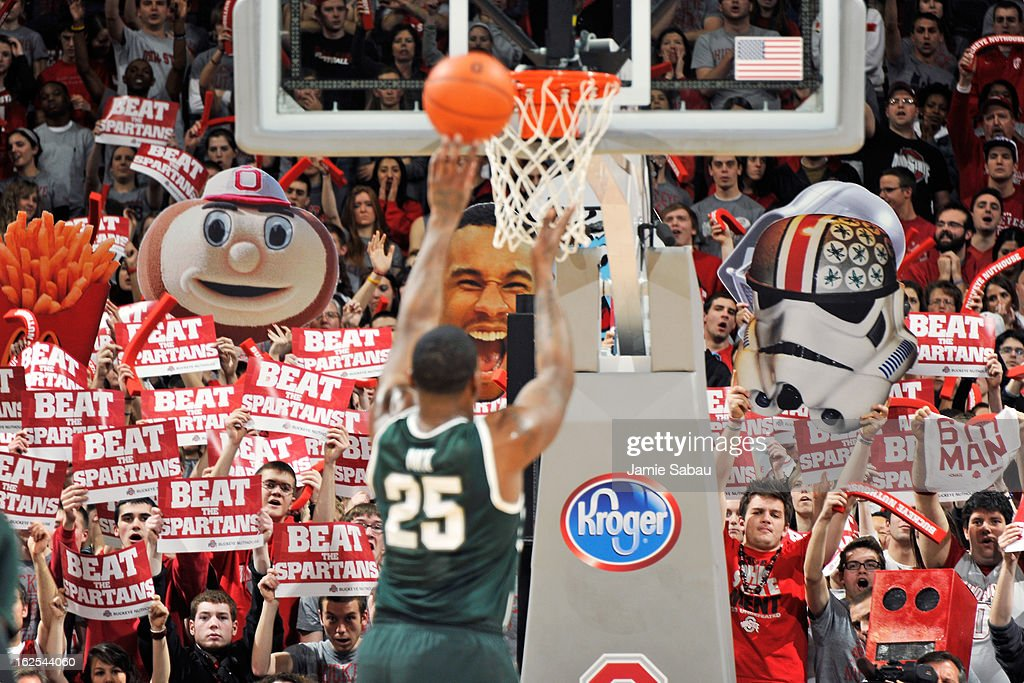 Ohio State fans attempt to distract Derrick Nix #25 of the Michigan State Spartans with signs and banners while Nix shoots a free throw against the Ohio State Buckeyes on February 24, 2013 at Value City Arena in Columbus, Ohio. Ohio State defeated Michigan State 68-60.