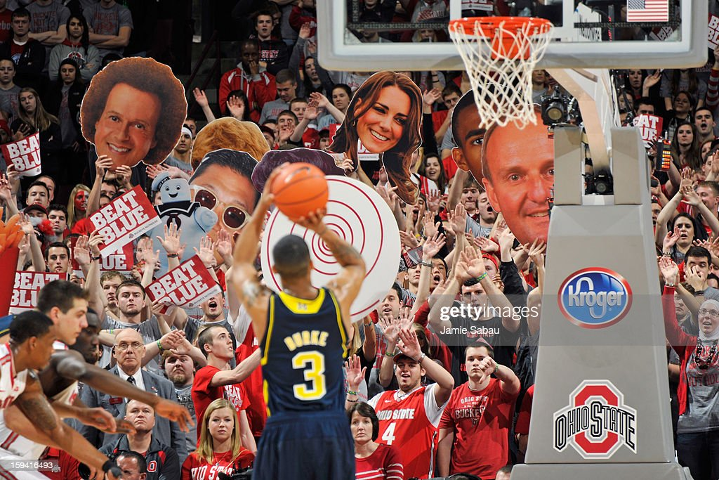 Ohio State fans attempt to distract Trey Burke #3 of the Michigan Wolverines as he shoots free throws in the second half against the Ohio State Buckeyes on January 13, 2013 at Value City Arena in Columbus, Ohio. Ohio State defeated Michigan 56-53.