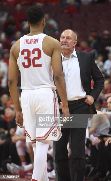 Ohio State head coach Thad Matta right speaks with Buckeyes center Trevor Thompson during action against Connecticut at Value City Arena in Columbus...