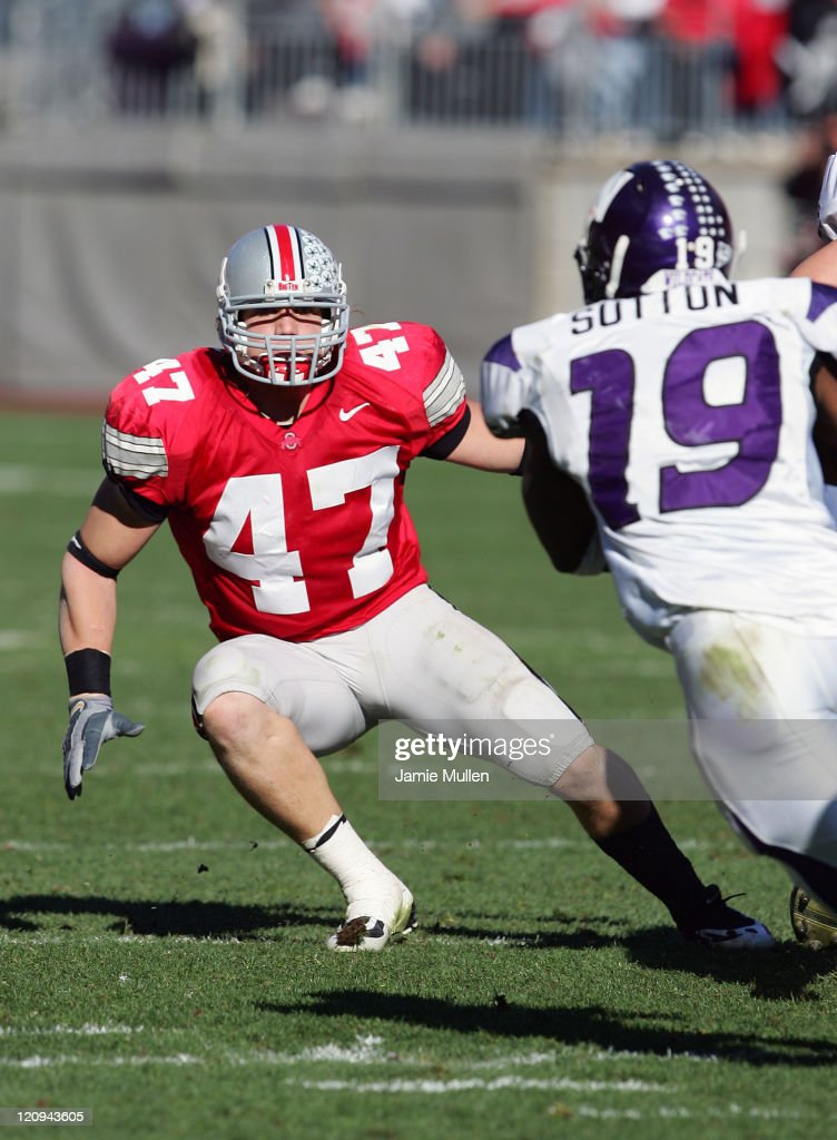 Ohio State Linebacker, <a gi-track='captionPersonalityLinkClicked' href=/galleries/search?phrase=A.J.+Hawk&family=editorial&specificpeople=648187 ng-click='$event.stopPropagation()'>A.J. Hawk</a>, sets his eyes on Northwestern's Tyrell Sutton during their game, November 12, 2005, at Ohio Stadium in Columbus, Ohio. The Buckeyes beat the Wildcats 48-7.