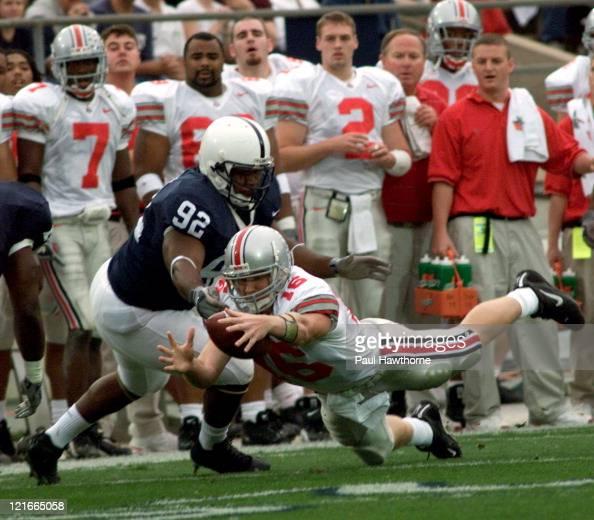 Ohio State quarterback Craig Krenzel fumbles the ball in the first half against Penn State at Beaver Stadium University Park Pennsylvaina November 1...