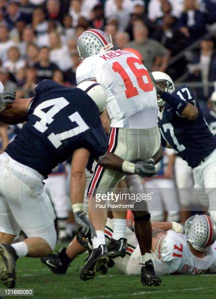 Ohio State quarterback Craig Krenzel gets hit and injured in the first half against Penn State at Beaver Stadium University Park Pennsylvaina...