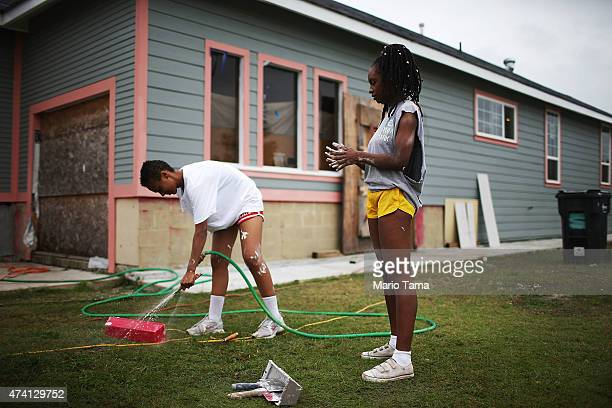 Ohio State student volunteers with lowernineorg help rebuild a home heavily damaged by Hurricane Katrina flooding in the Lower Ninth Ward on May 15...