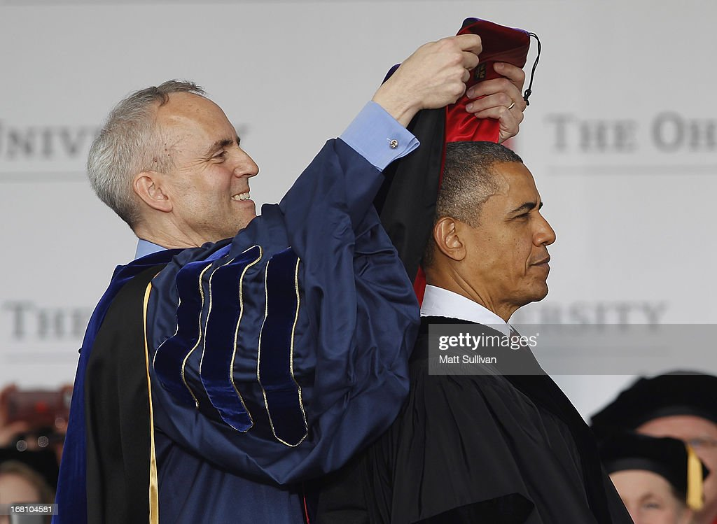 Ohio State Trustee David Horn (L) puts a sash on U.S. President <a gi-track='captionPersonalityLinkClicked' href=/galleries/search?phrase=Barack+Obama&family=editorial&specificpeople=203260 ng-click='$event.stopPropagation()'>Barack Obama</a> during commencement ceremonies at The Ohio State University at Ohio Stadium on May 5, 2013 in Columbus, Ohio. Obama addressed the graduates a year from the day he kicked off his re-election campaign at the campus.The president was also given an honorary degree Doctor of Laws.