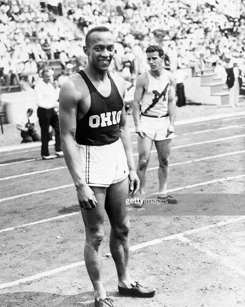 Ohio State University track star Jesse Owens stands on the track after winning the first heat of the 100meter dash competition with a time of 105...