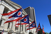 State of Ohio flags waving in front of the Statehouse in Columbus, OG.