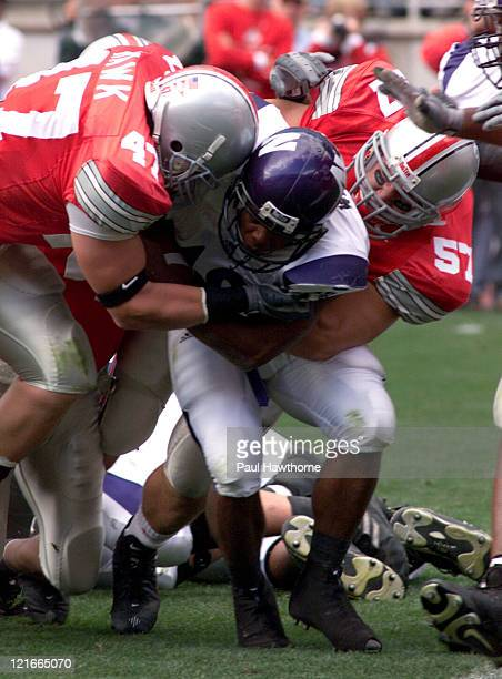 Ohio StateÆs AJ Hawk and Mike Kudla wrap up NorthwesternÆs Jason Wright during first qtr action at Ohio Stadium in Columbus Ohio September 27 2003...