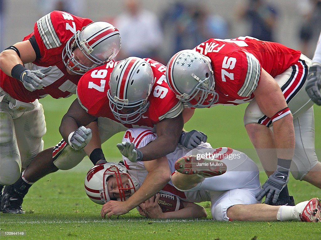 Ohio State's <a gi-track='captionPersonalityLinkClicked' href=/galleries/search?phrase=A.J.+Hawk&family=editorial&specificpeople=648187 ng-click='$event.stopPropagation()'>A.J. Hawk</a> (47), David Patterson (97), and Simon Fraser (75) converge on Wisconsin's <a gi-track='captionPersonalityLinkClicked' href=/galleries/search?phrase=John+Stocco&family=editorial&specificpeople=208773 ng-click='$event.stopPropagation()'>John Stocco</a> during their game, Saturday October 9, 2004, in Columbus. Wisconsin beat Ohio State 24-13.