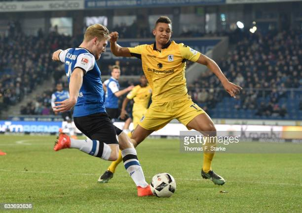 Ohis Felix Uduokhai of Munich and Andreas Voglsammer of Bielefeld fight for the ball during the Second Bundesliga match between DSC Arminia Bielefeld...