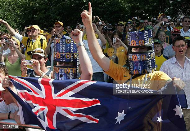 Australian fans wearing Ned Kelly helmets made from beer cartons cheer on the Socceroos during their open training session in Ohringen 19 June 2006...