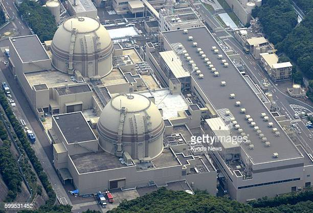 Oi Japan Photo from a Kyodo News helicopter shows the No 4 reactor building at Kansai Electric Power Co's Oi nuclear power plant in the town of Oi...