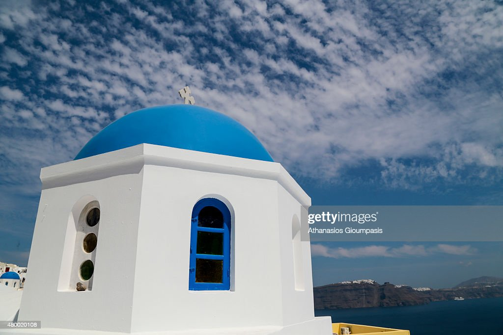 Oia church with cupola painted blue and white washed walls on June 30 2015 in Santorini Greece Oia typifies the white painted houses of the Cyclades...