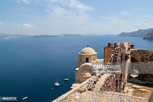 Oia old church with wonderful views to the sea caldera and volcano on June 30 2015 in Santorini Greece Oia typifies the white painted houses of the...