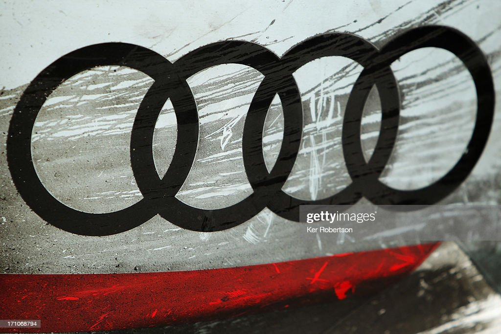 Oil and dirt are seen on last years winning Audi Sport e-tron quattro as it is displayed during previews for the Le Mans 24 Hour race at the Circuit de la Sarthe on June 21, 2013 in Le Mans, France.
