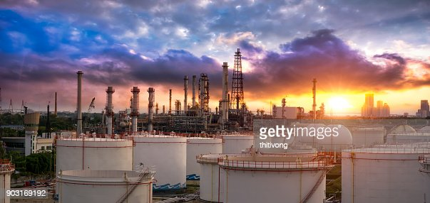 Oil and gas industry - refinery factory - petrochemical plant at sunset : Stock Photo