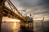 Oil and gas platform in sunrise or sunset time.