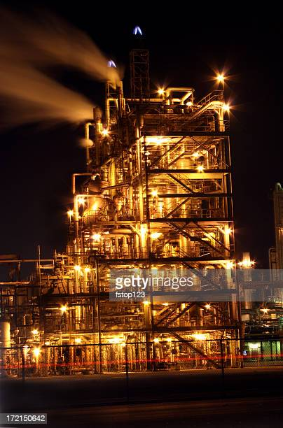 Oil and gas refinery at night. Lights. Smoke.