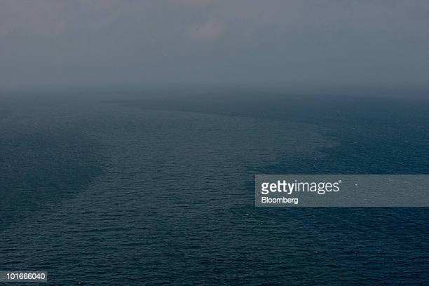 Oil appears as a sheen on the surface of the water in the Gulf of Mexico near the coast of Louisiana US on Saturday June 5 2010 The biggest oil spill...