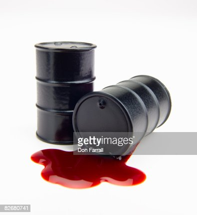 Oil barrels spilling blood : Stock Photo