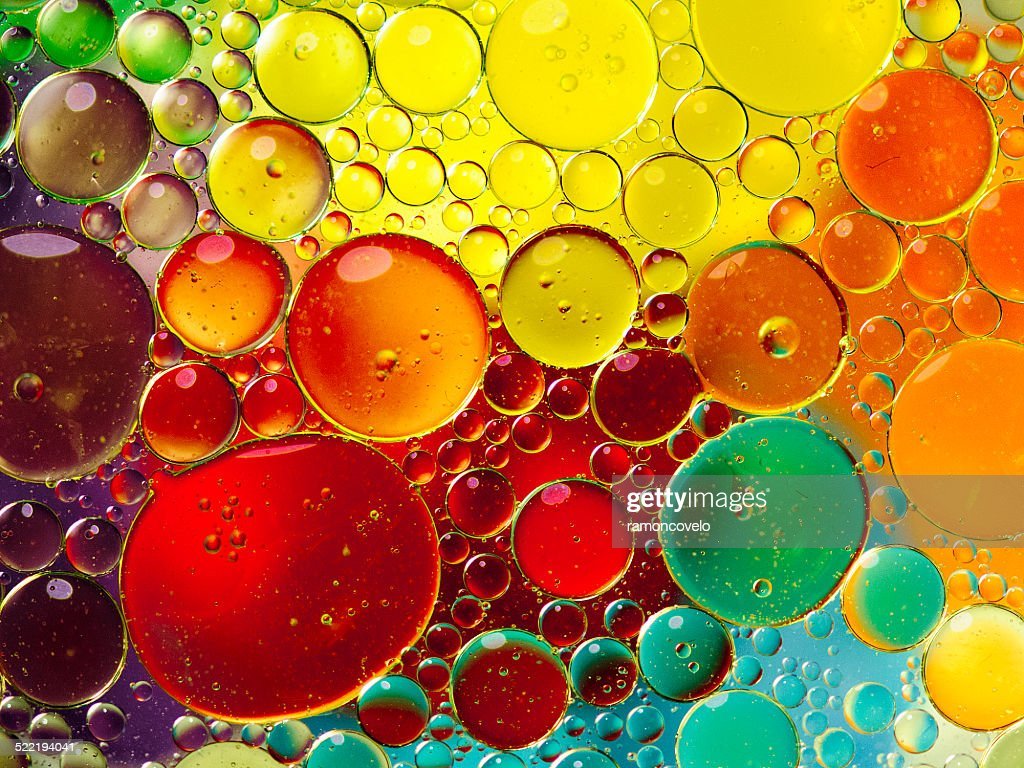 Oil bubbles in water : Stock Photo