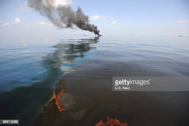 Oil burns during a controlled fire May 6 2010 in the Gulf of Mexico The US Coast Guard is overseeing oil burns after the sinking and subsequent...