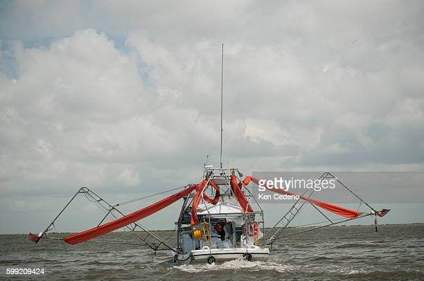 Oil covered barrier booms atop a vessel of opportunity searches for more oil slicks in the marshlands of the Houma Navigation channel in southern...