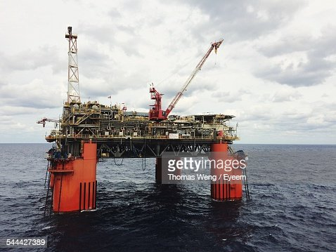 Oil Drilling Platform On Sea Against Cloudy Sky
