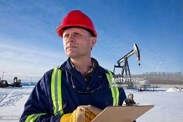 Oil Engineer at a Pumpjack