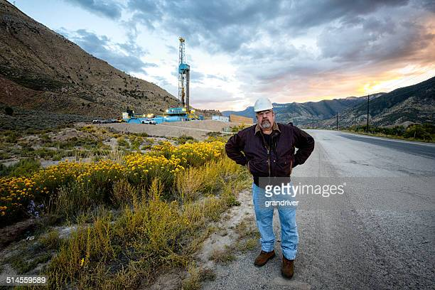 Oil Field Worker and Fracking Drill Rig