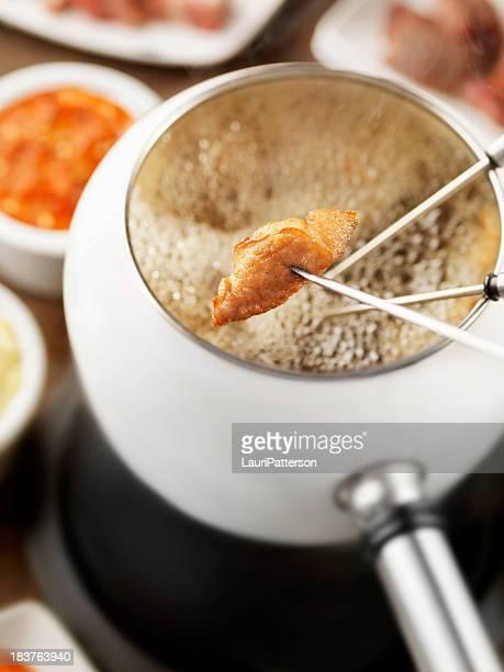 Öl-Fondue mit Huhn