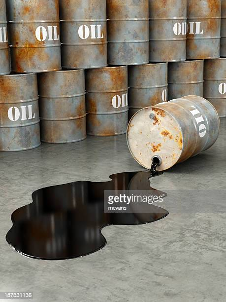 Oil gallons stacked and one gallon spilling oil