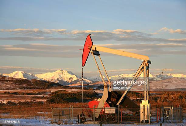 Oil Industry Pumpjack and Rocky Mountains