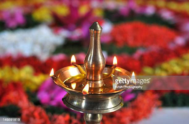 Oil Lamp and Floral arrangement.