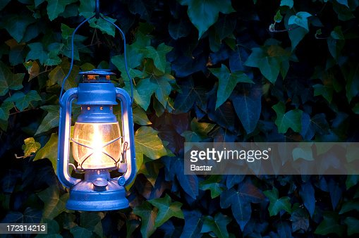Oil lamp illuminating an outside environment
