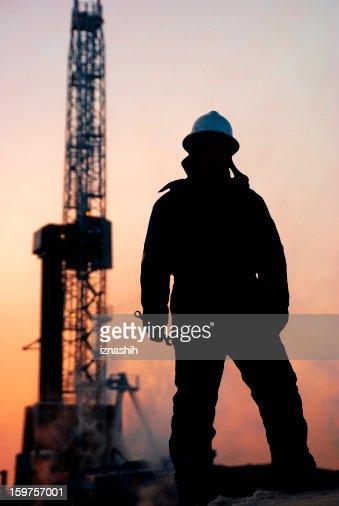 Oil man at dusk