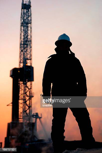 Oil man at dusk