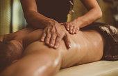 Man on a back oil massage