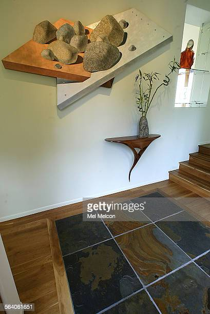Oil painting of rocks located in entry way of Al and Myra Rosen's home in Brentwood Floor is a combination of certified cherry wood and slate Digital...