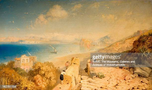 Oil painting showing a bay with a deep blue sea The ruins of a castle in light stone lead down to a sandy beach There are figures on the ruins Signed...