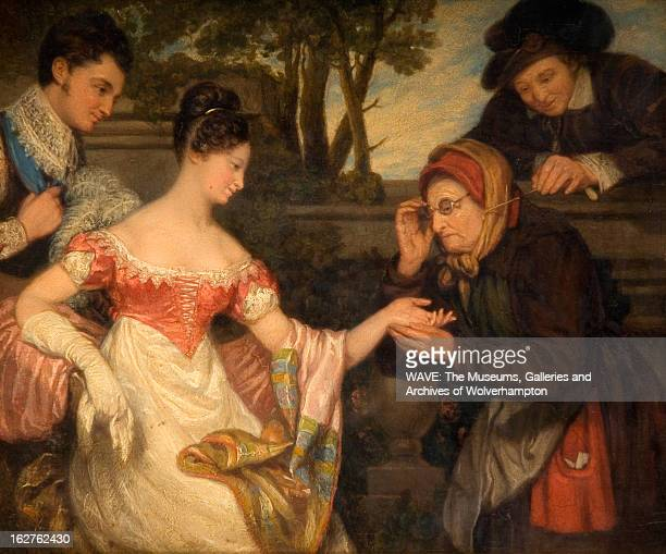 Oil painting showing a wealthy well dressed woman having her palm read by an elderly fortune teller A man accompanies each woman and they are...