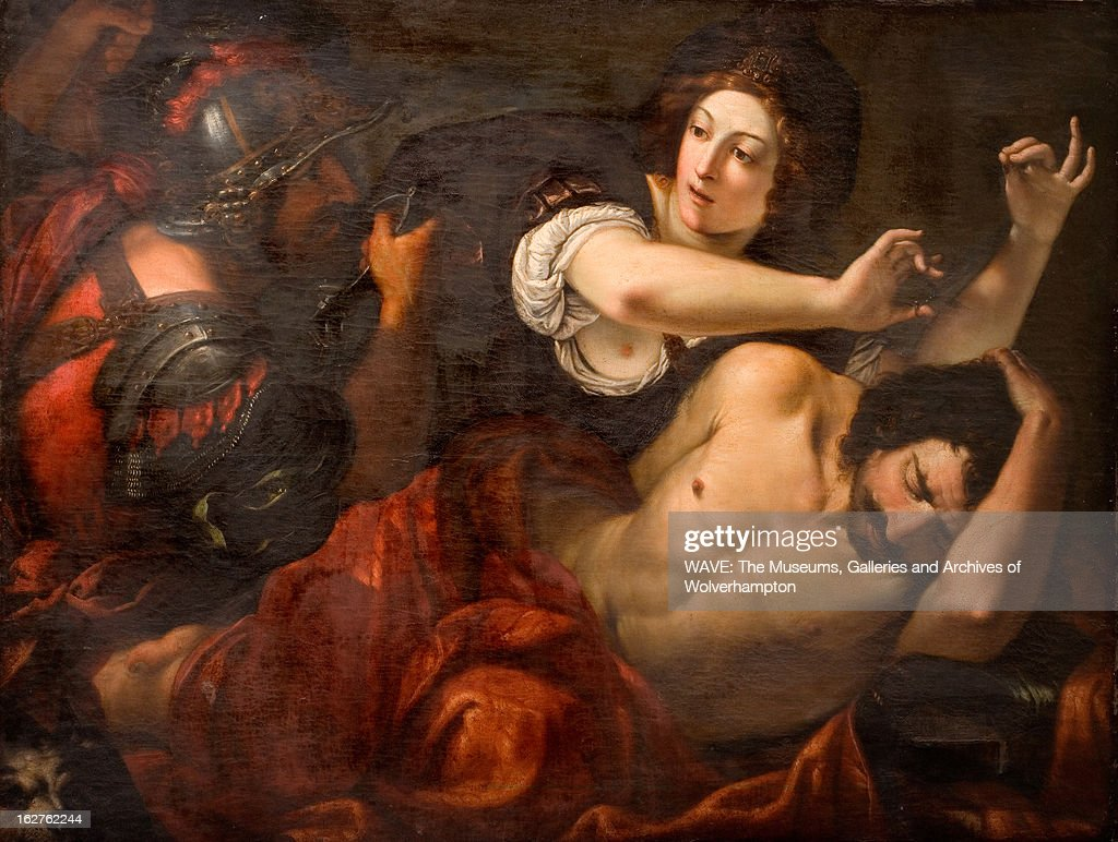 Oil painting showing <a gi-track='captionPersonalityLinkClicked' href=/galleries/search?phrase=Samson&family=editorial&specificpeople=79382 ng-click='$event.stopPropagation()'>Samson</a> lying down trying to protect his hair from the scissors in <a gi-track='captionPersonalityLinkClicked' href=/galleries/search?phrase=Delilah+-+Biblical+Character&family=editorial&specificpeople=79383 ng-click='$event.stopPropagation()'>Delilah</a>'s hand, A soldier is waiting to arrest <a gi-track='captionPersonalityLinkClicked' href=/galleries/search?phrase=Samson&family=editorial&specificpeople=79382 ng-click='$event.stopPropagation()'>Samson</a>. <a gi-track='captionPersonalityLinkClicked' href=/galleries/search?phrase=Samson&family=editorial&specificpeople=79382 ng-click='$event.stopPropagation()'>Samson</a> and <a gi-track='captionPersonalityLinkClicked' href=/galleries/search?phrase=Delilah+-+Biblical+Character&family=editorial&specificpeople=79383 ng-click='$event.stopPropagation()'>Delilah</a>, 1600-1699. Oil Painting by North Italian School (.